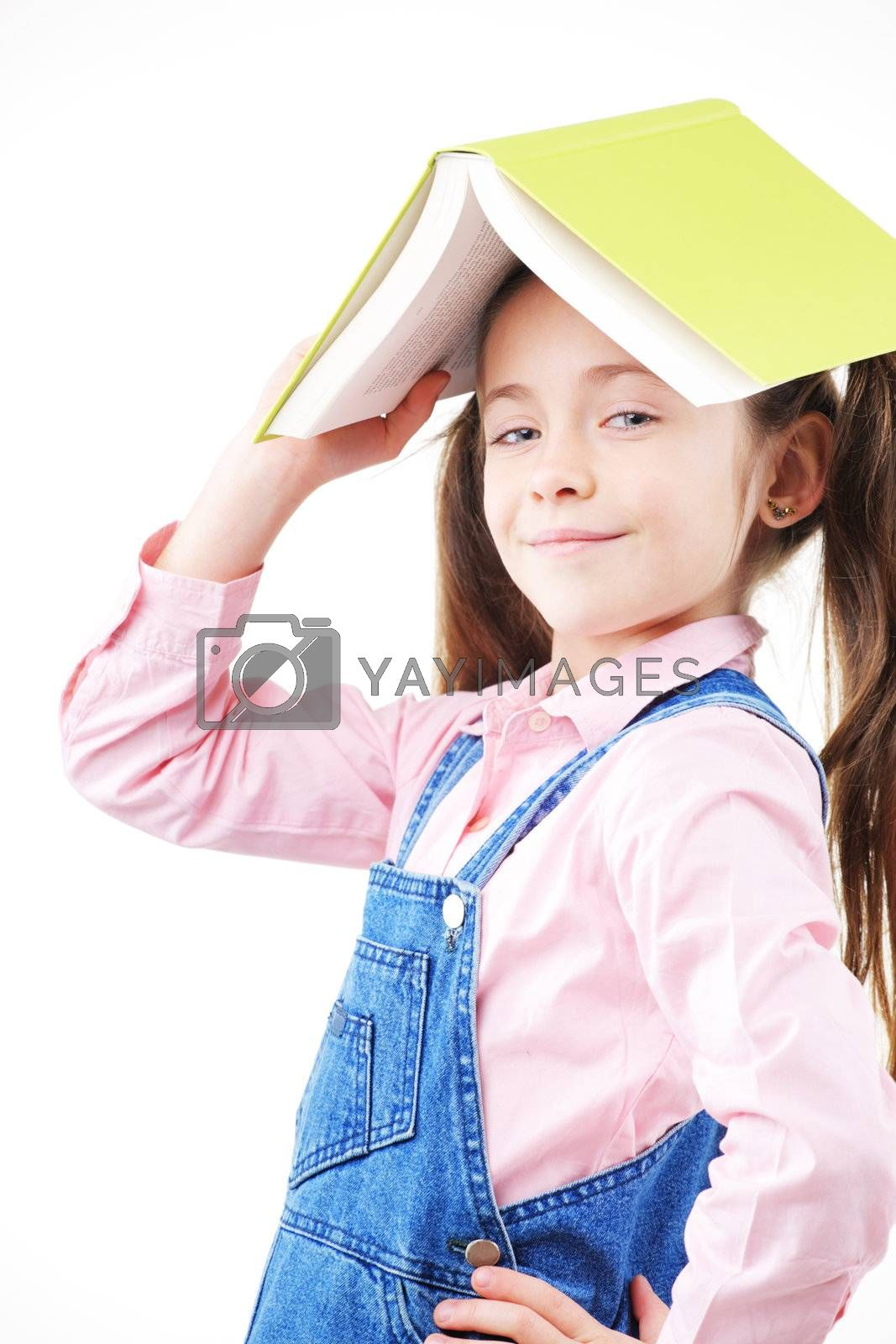 Cute girl with book on white background