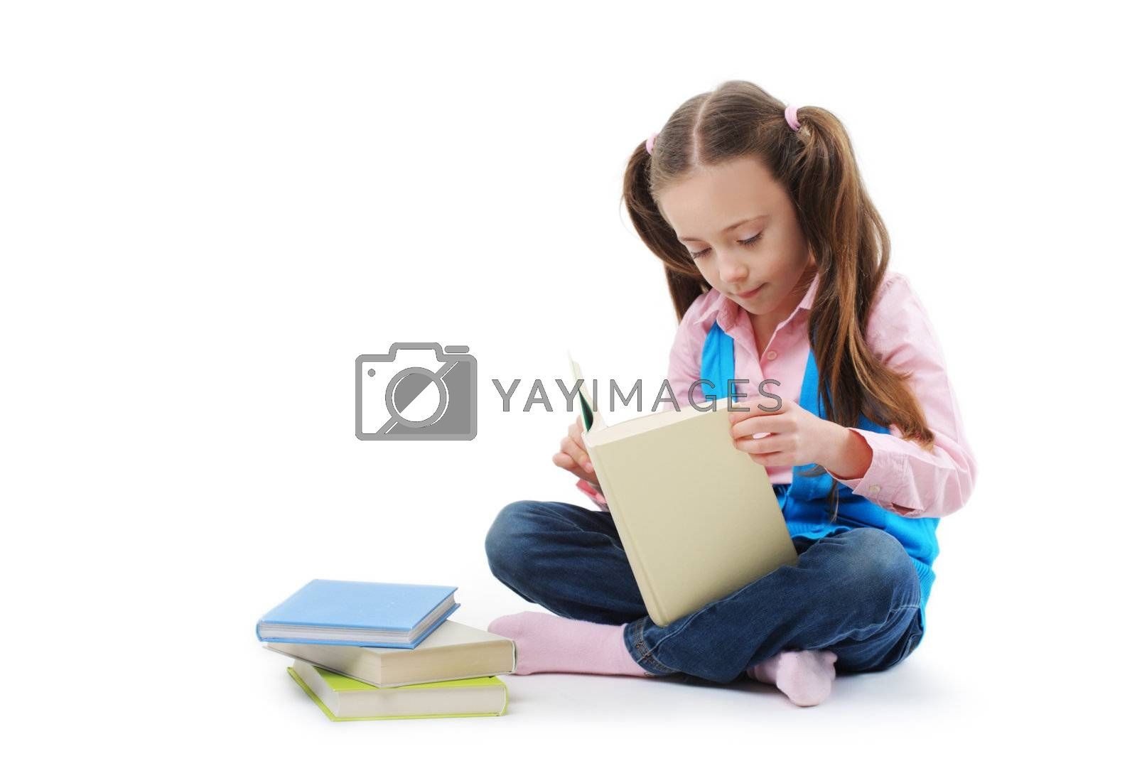Schoolgirl reading a book on white background