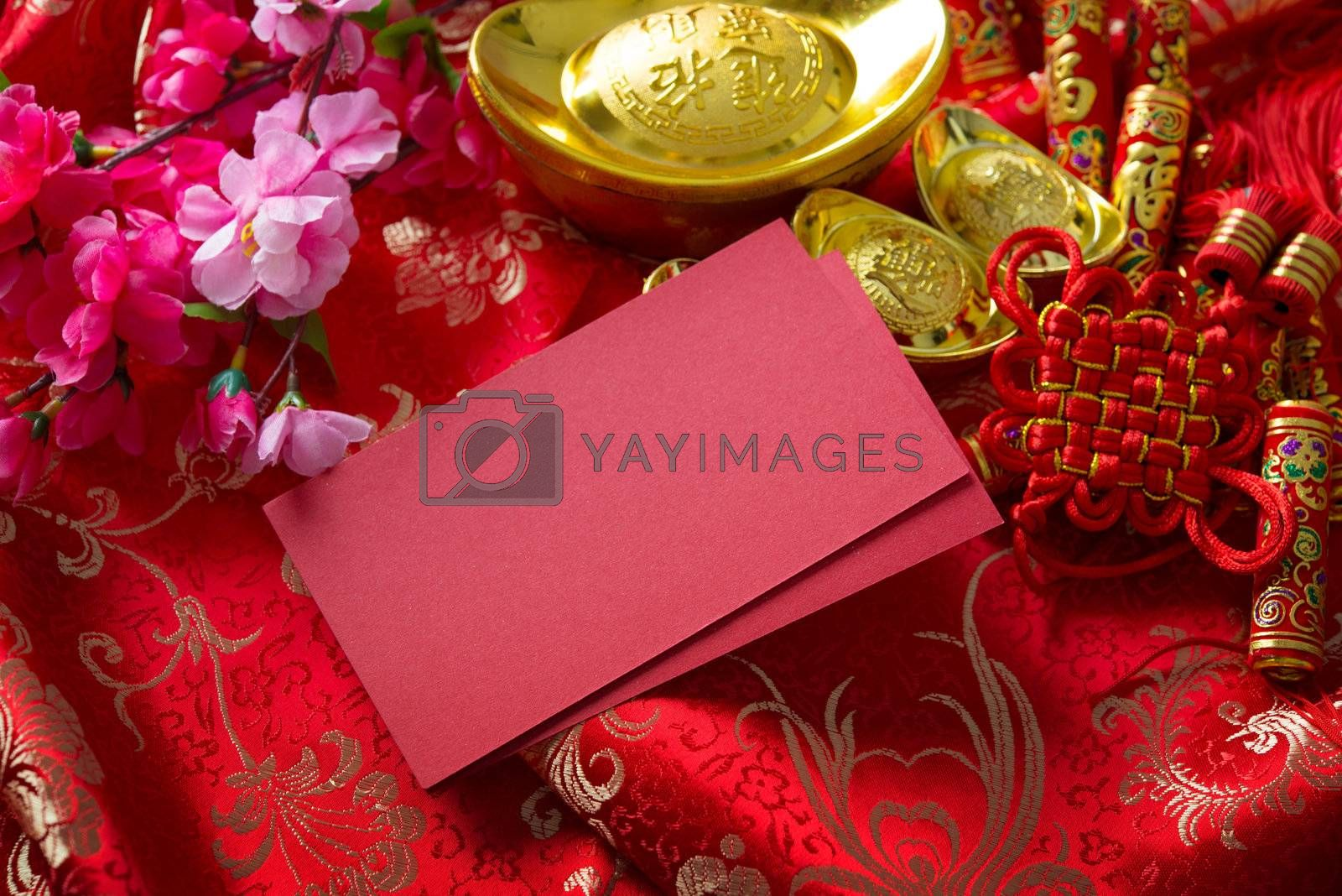 Chinese new year festival decorations , the chinese character on the gold ingots means fortune and luck
