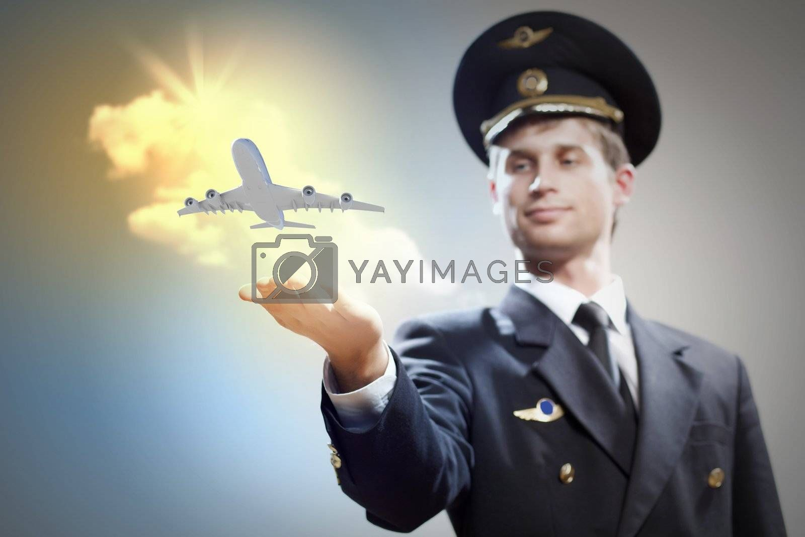 Royalty free image of Image of pilot with plane in hand by sergey_nivens