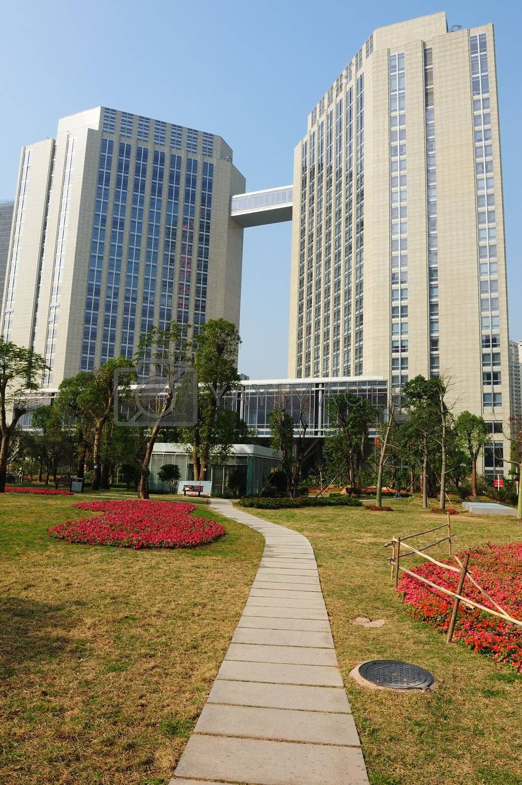 Path leading to buildings in Guangzhou Flower Citizen Plaza