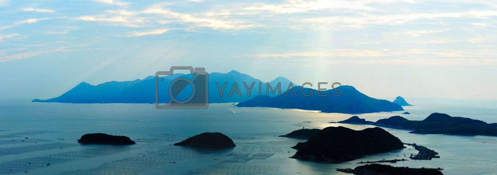 Ocean landscape with sunshine, islands and mountains