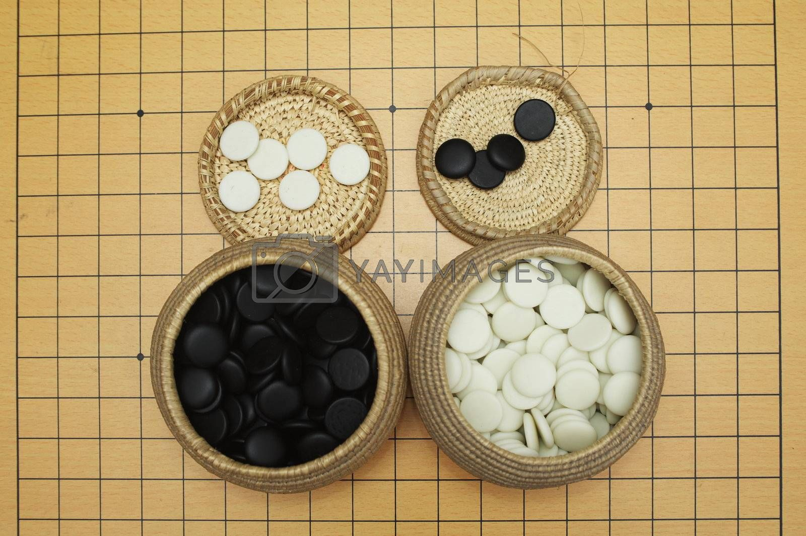 Go game board , black and white stones and boxes