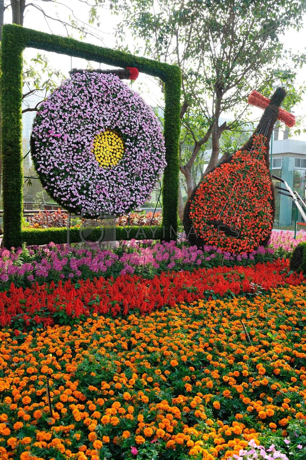 Chinese traditional musical instruments made of flowers in Flower Citizen Plaza, Guangzhou city, China