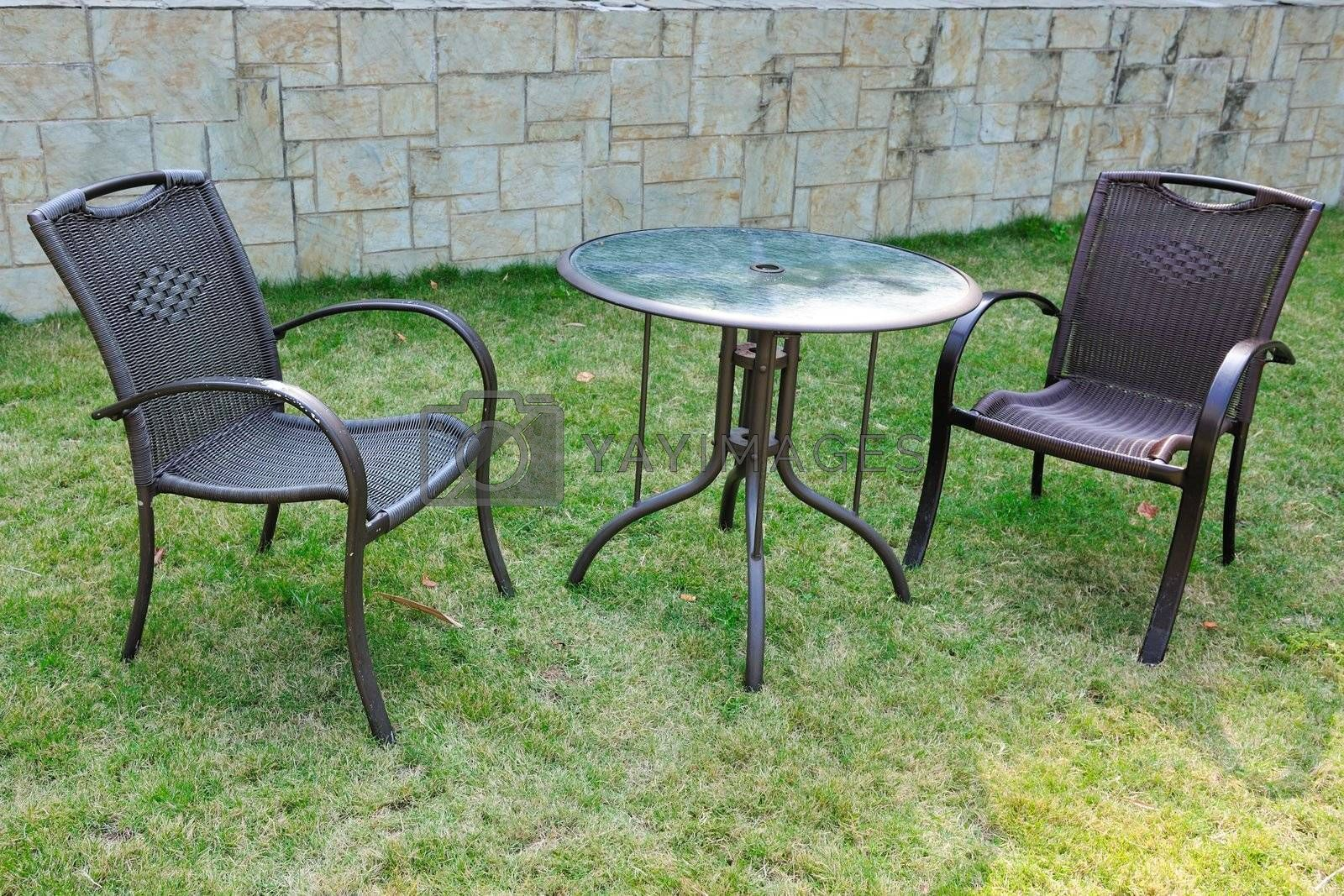 Table and chairs in the yard