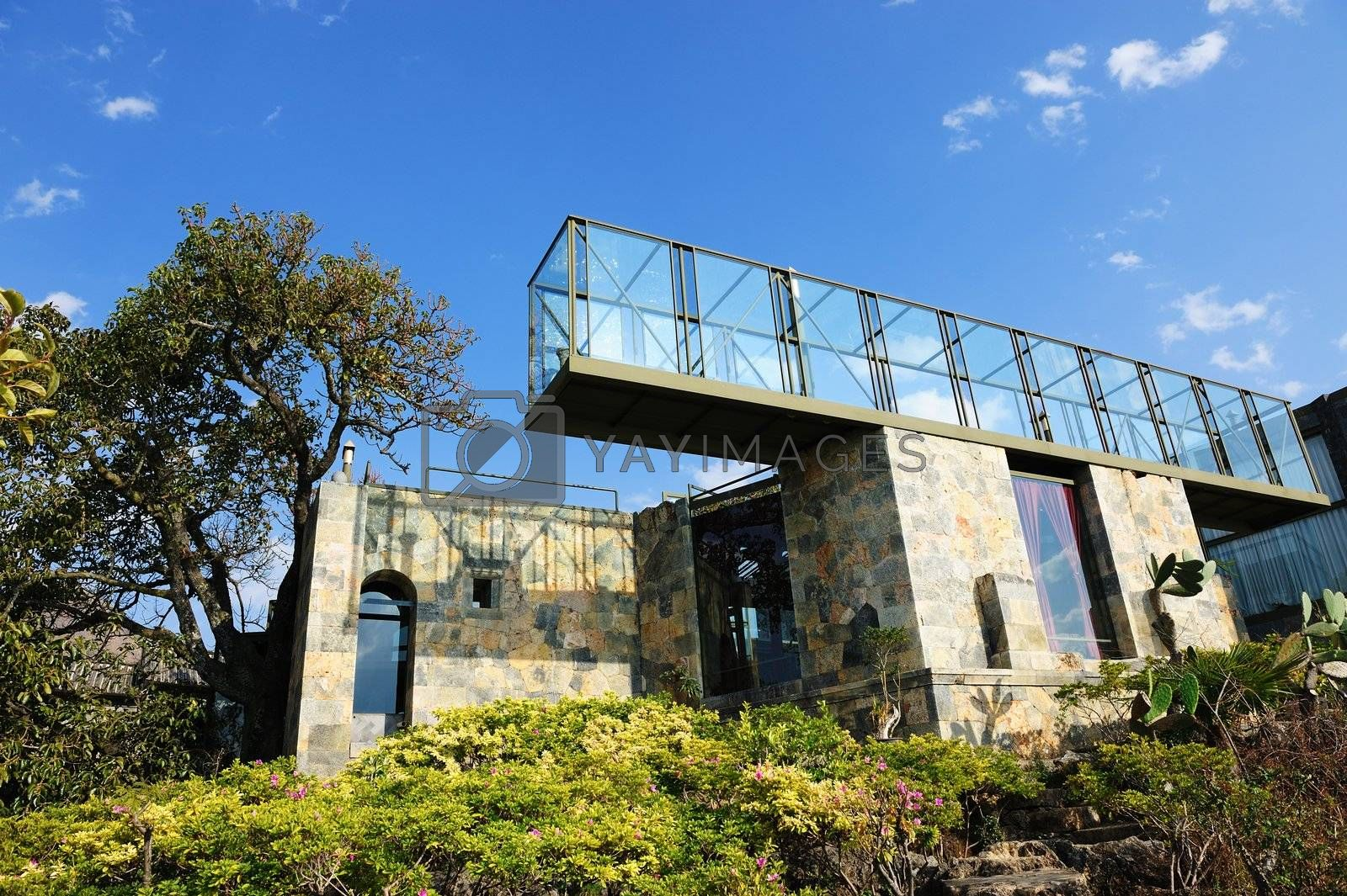 Modern villa made of stones and glasses