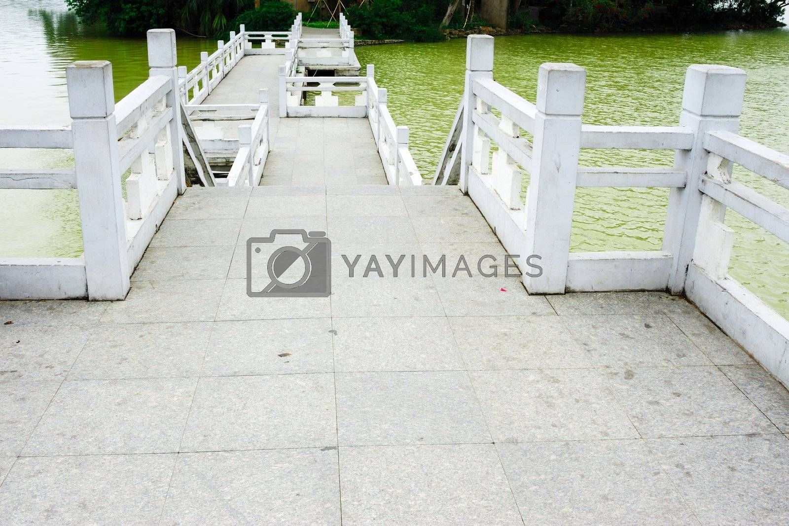 Traditional Chinese old bridge with turnings in the park
