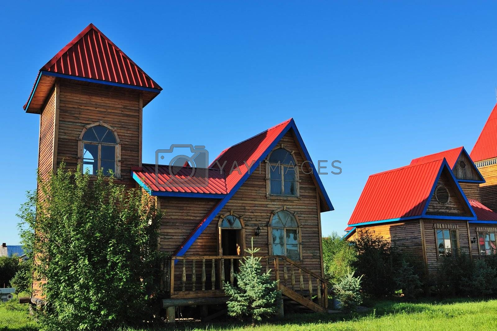 Wooden cabin under the blue sky