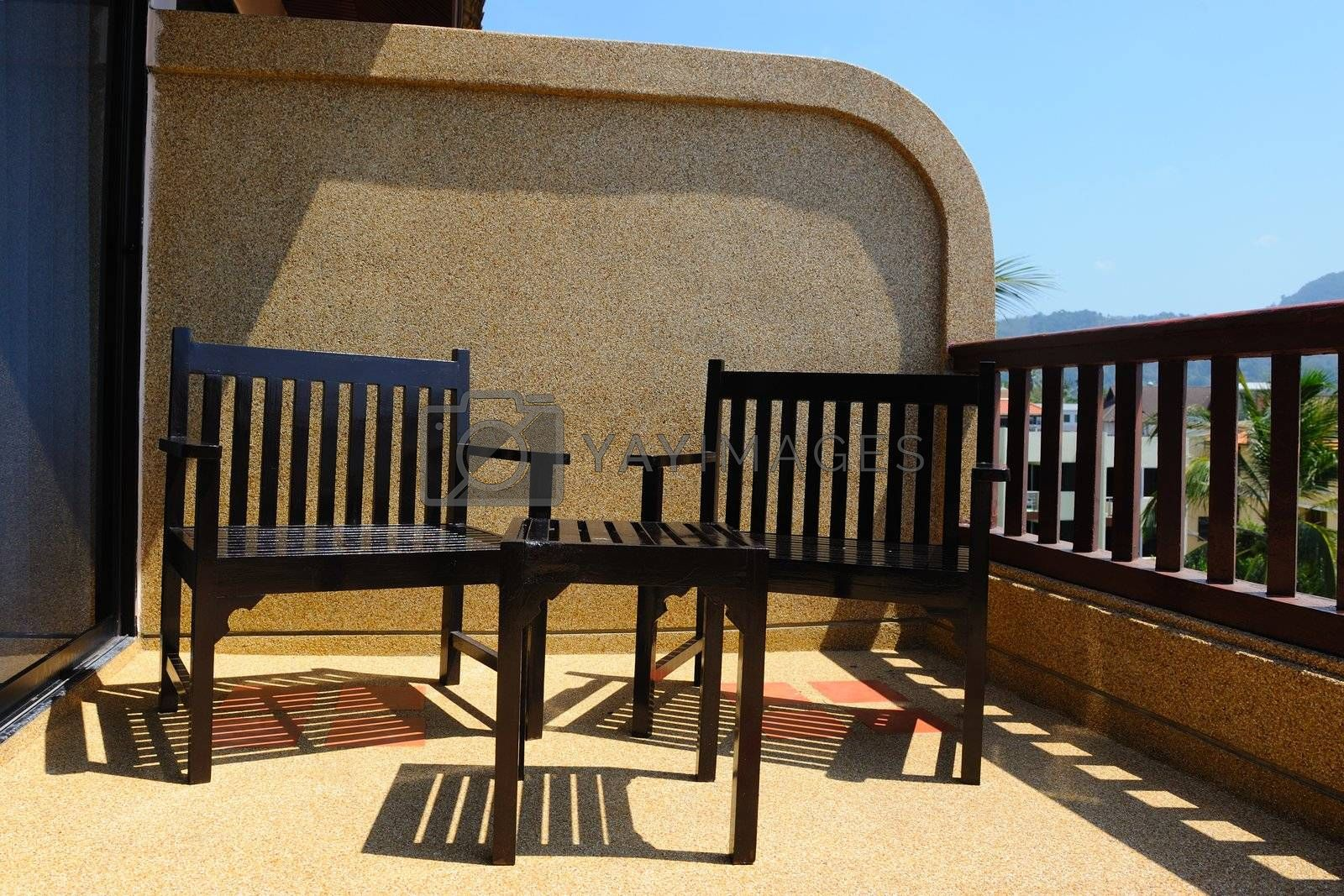 Table and chairs on the sunny balcony