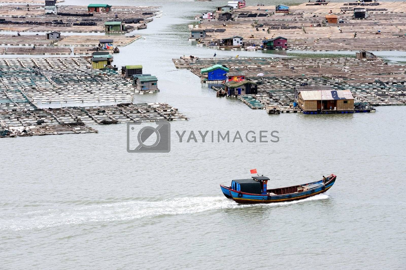 Sea village and boat on the ocean in Fujian province of China