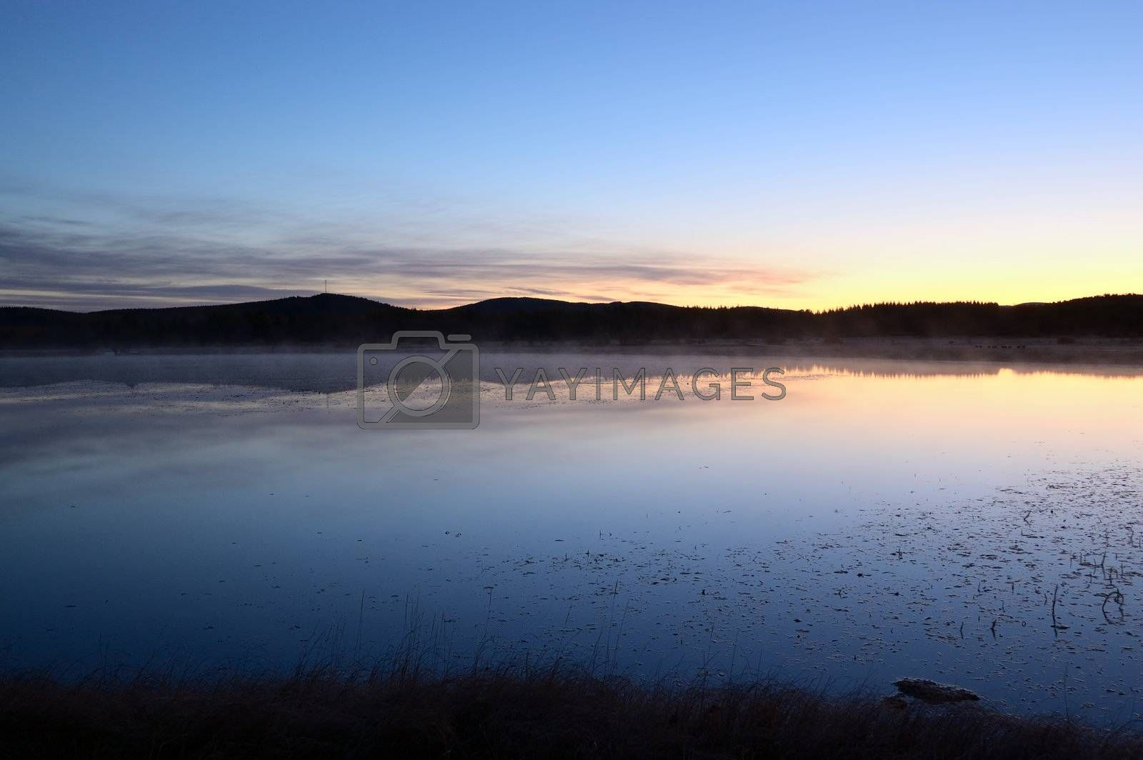 Landscape of lake sunrise at dawn near the grassland in Hebei province of China