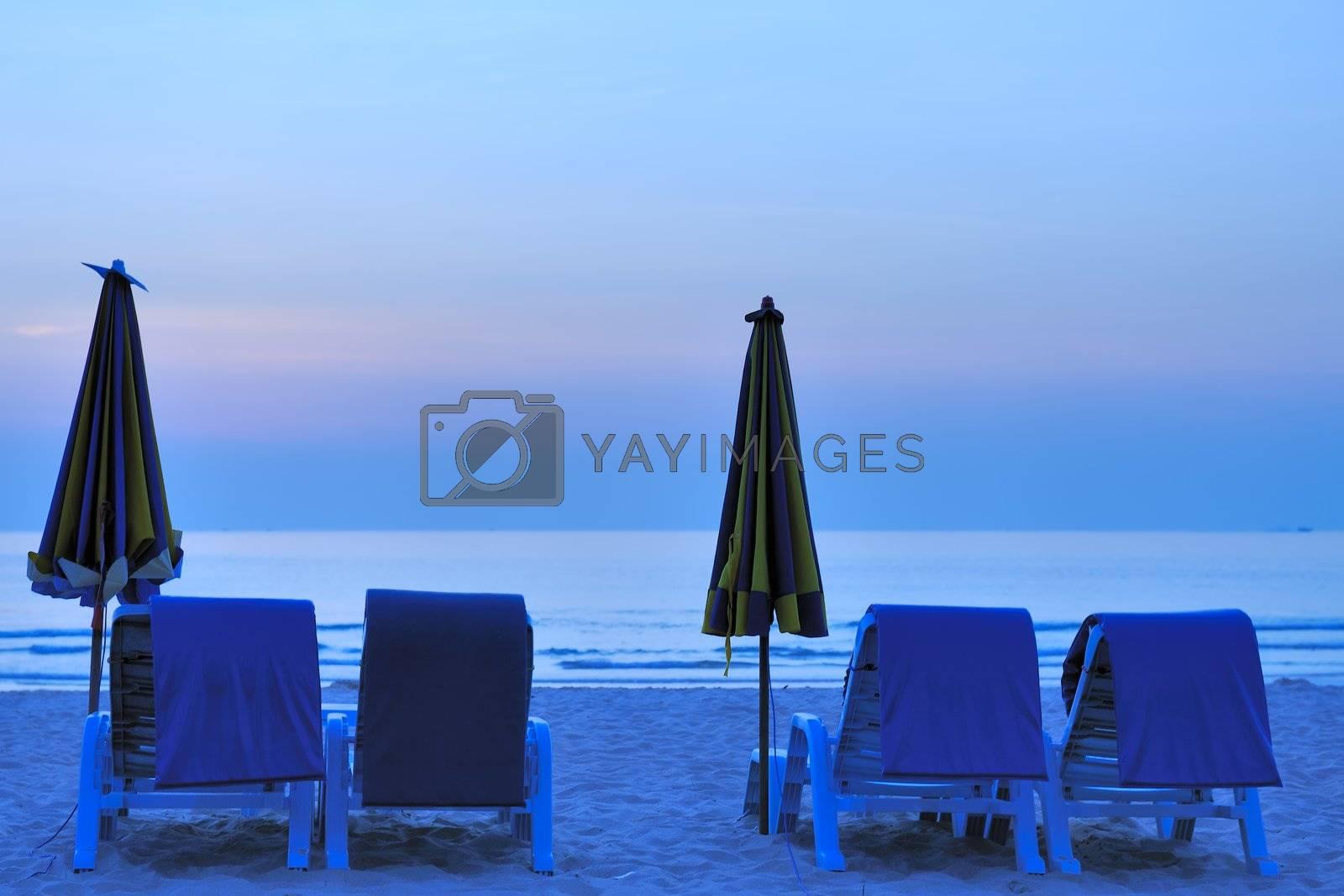Beach landscape with two folded umbrella in Phuket Island, Thailand