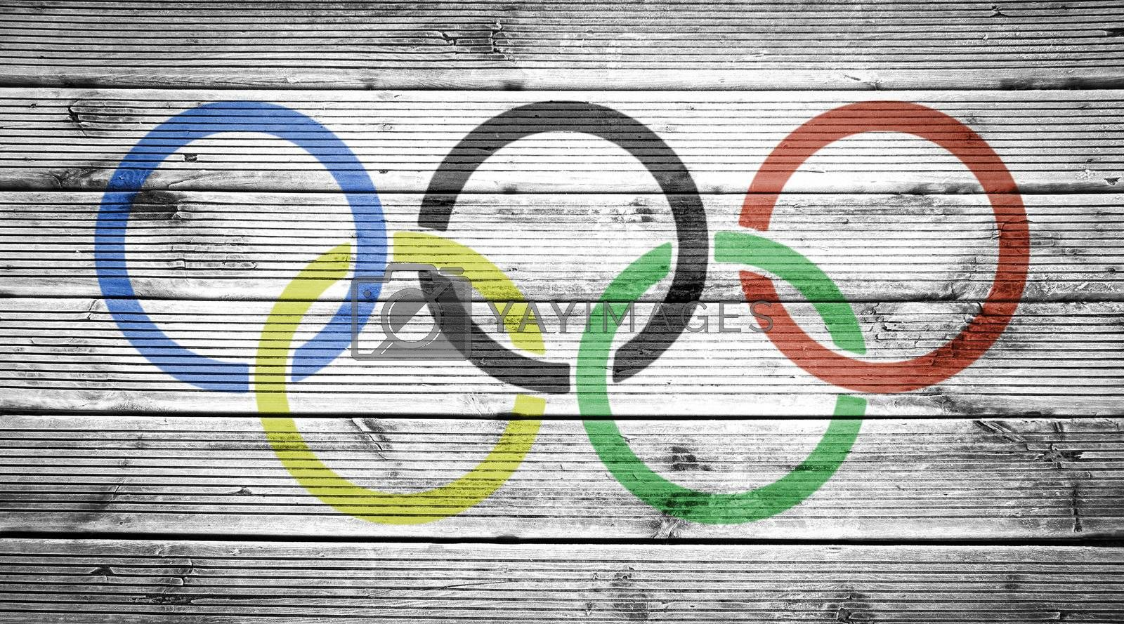 Natural wood planks texture background with the colors of the flag of Olimpic Games