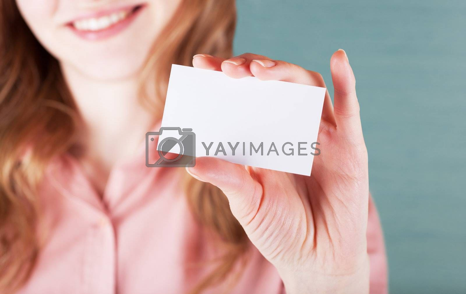 Image of smiling business woman holding her visiting card