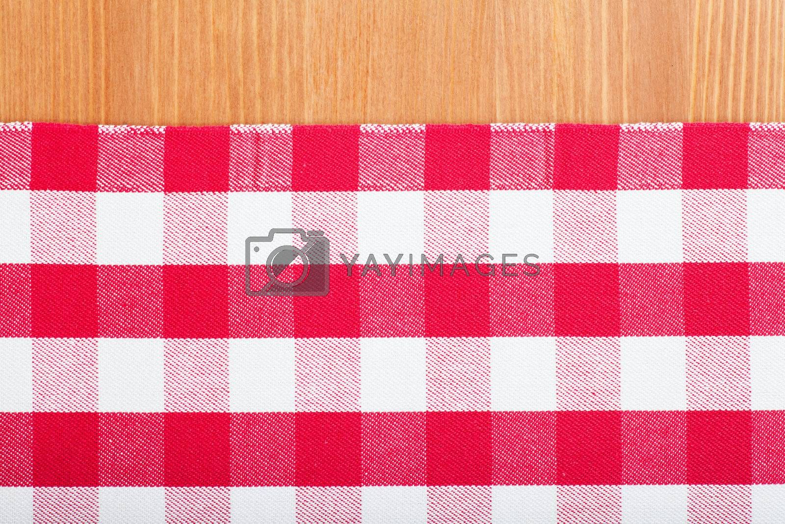 Checked with red and white tablecloth on a wooden table