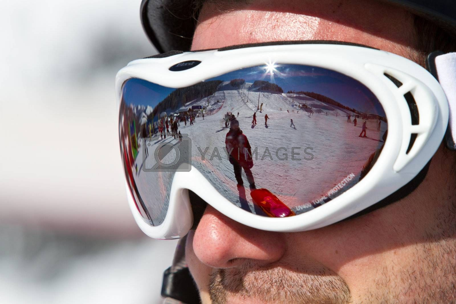 The man in the mountain-skiing form in a helmet and glasses