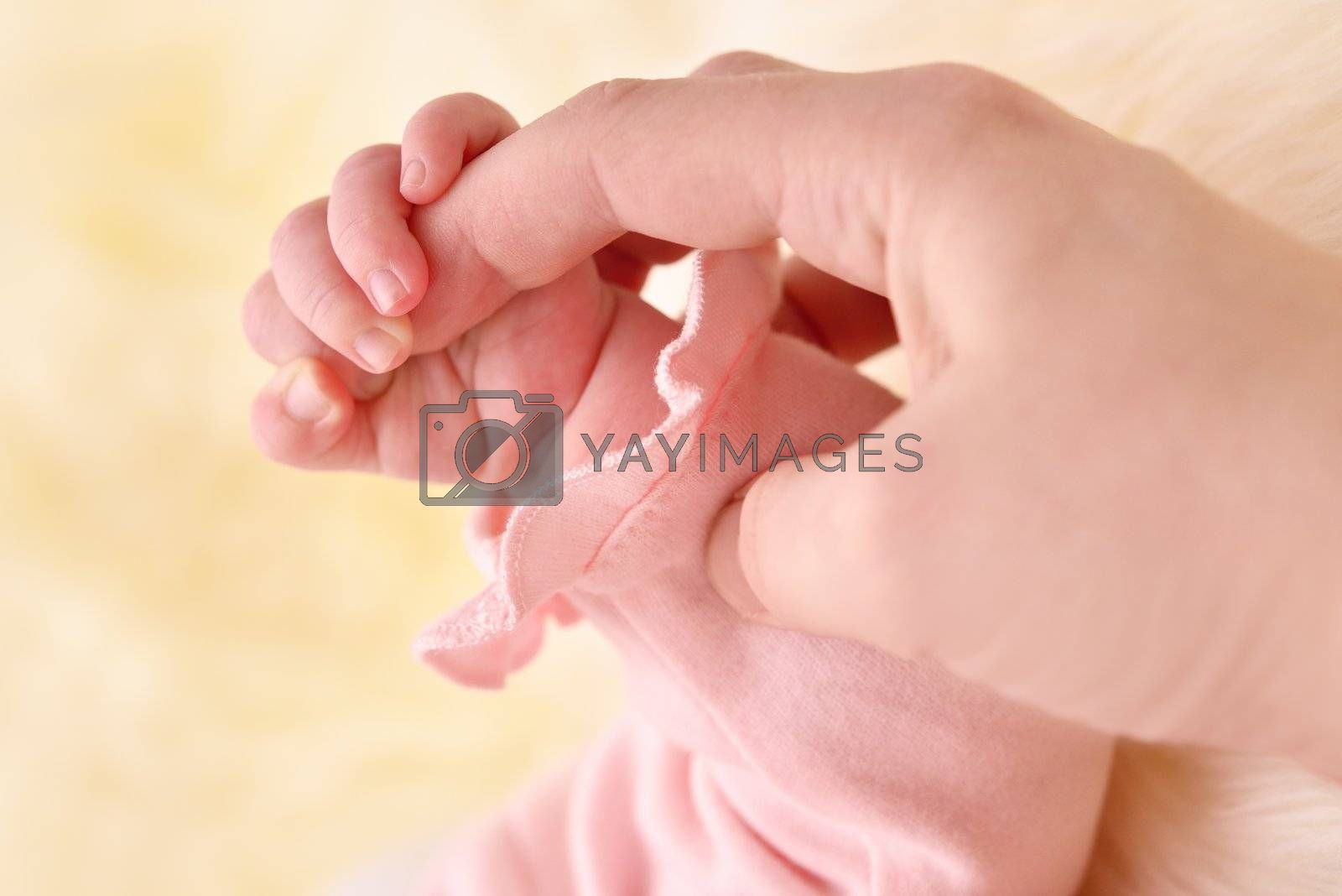Child's hand holding an mother finger.