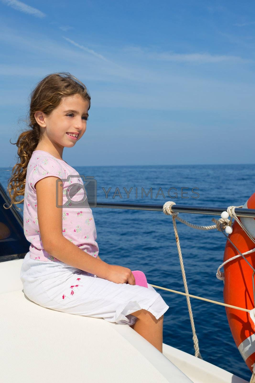 child happy girl sailing happy  boat  at blue sea ocean