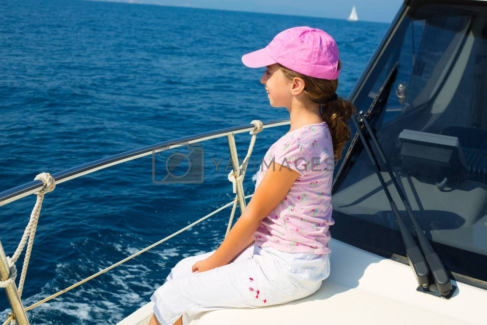 child happy girl sailing happy  boat with cap at blue sea ocean
