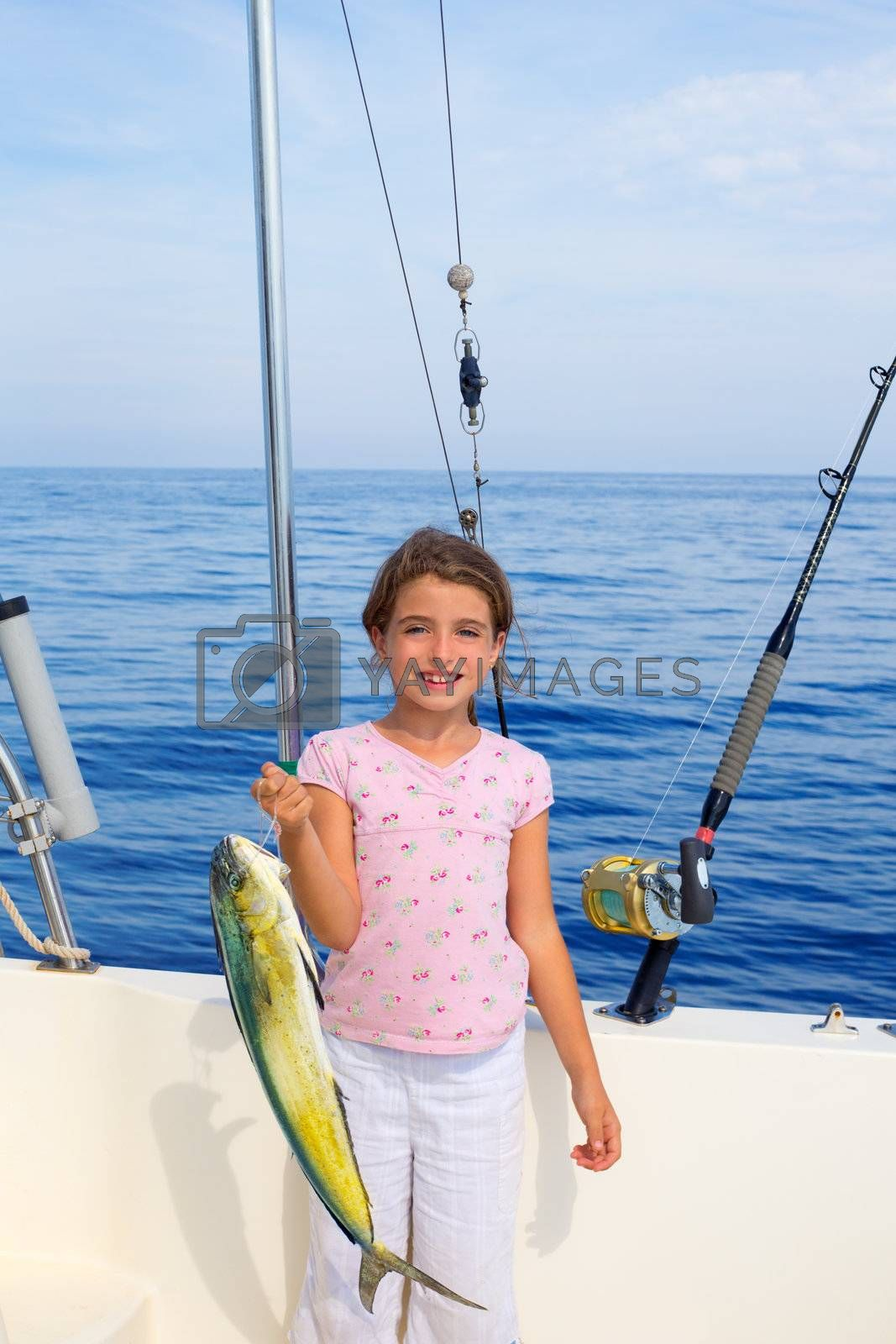 child girl fishing in boat with mahi mahi dorado fish catch with rod and trolling reels