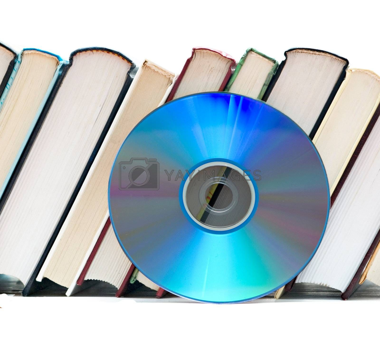 Row of books  and DVD disk as symbols of old and new methods of information storage