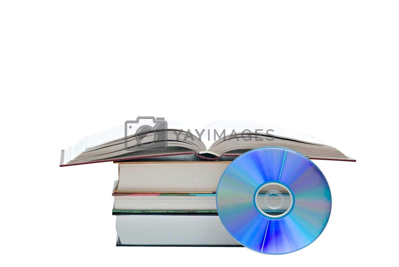 Pile of books, open book,  and DVD disk as symbols of old and new methods of information storage