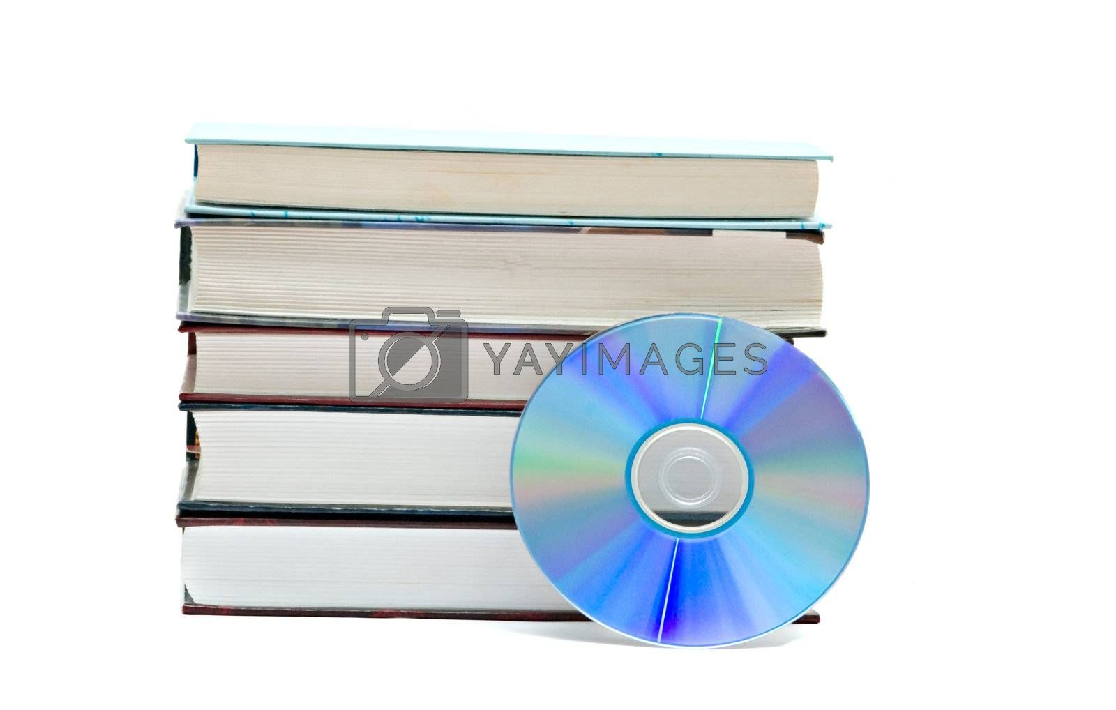 Pile of books and DVD disk as symbols of old and new methods of information storage