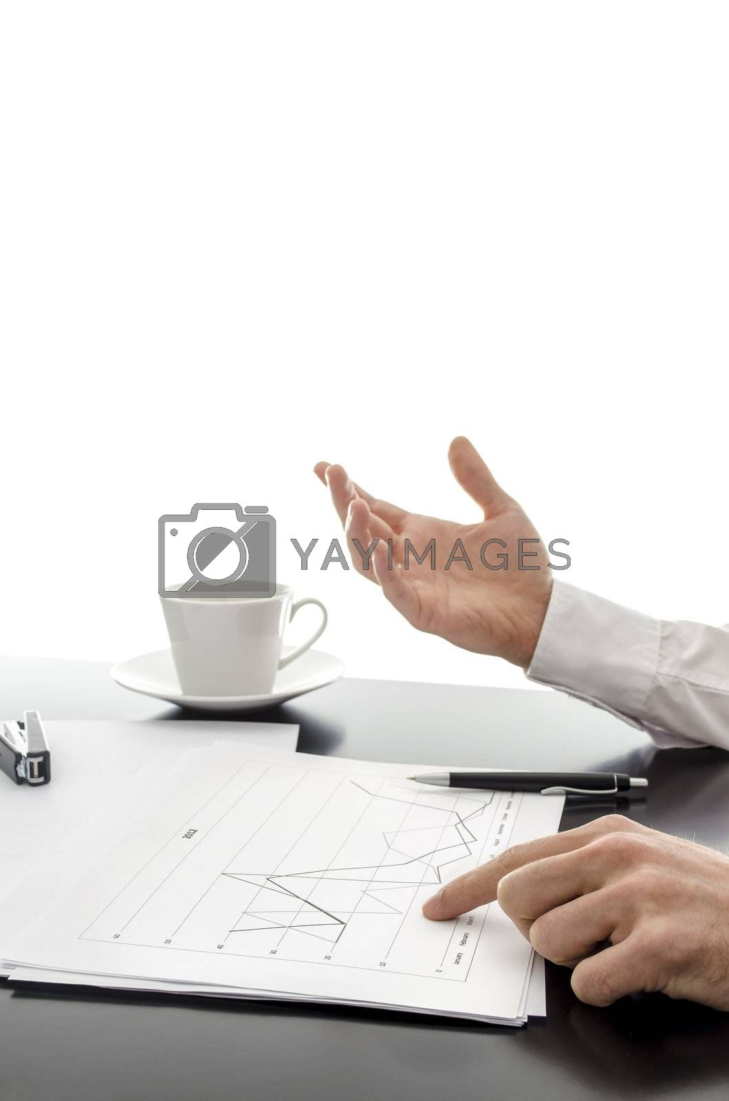 Businessman explaining financial reports on a black desk. With white background.
