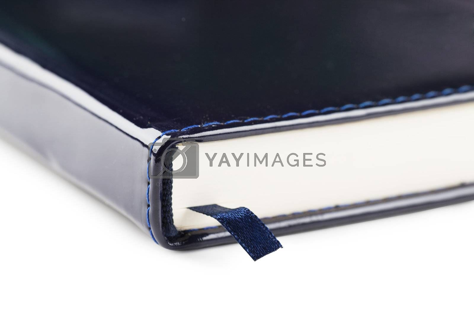 Closeup view of bookmark in a blue organizer over white background