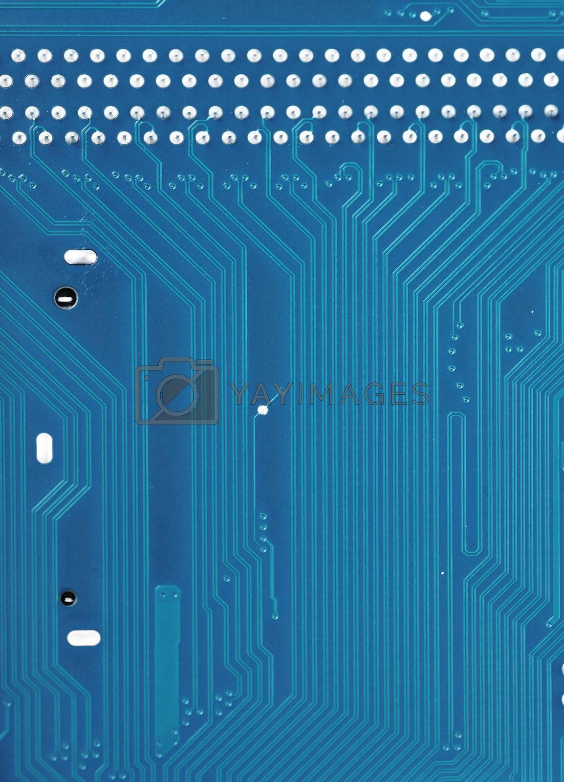 Closeup view of tracks of blue printed circuit board