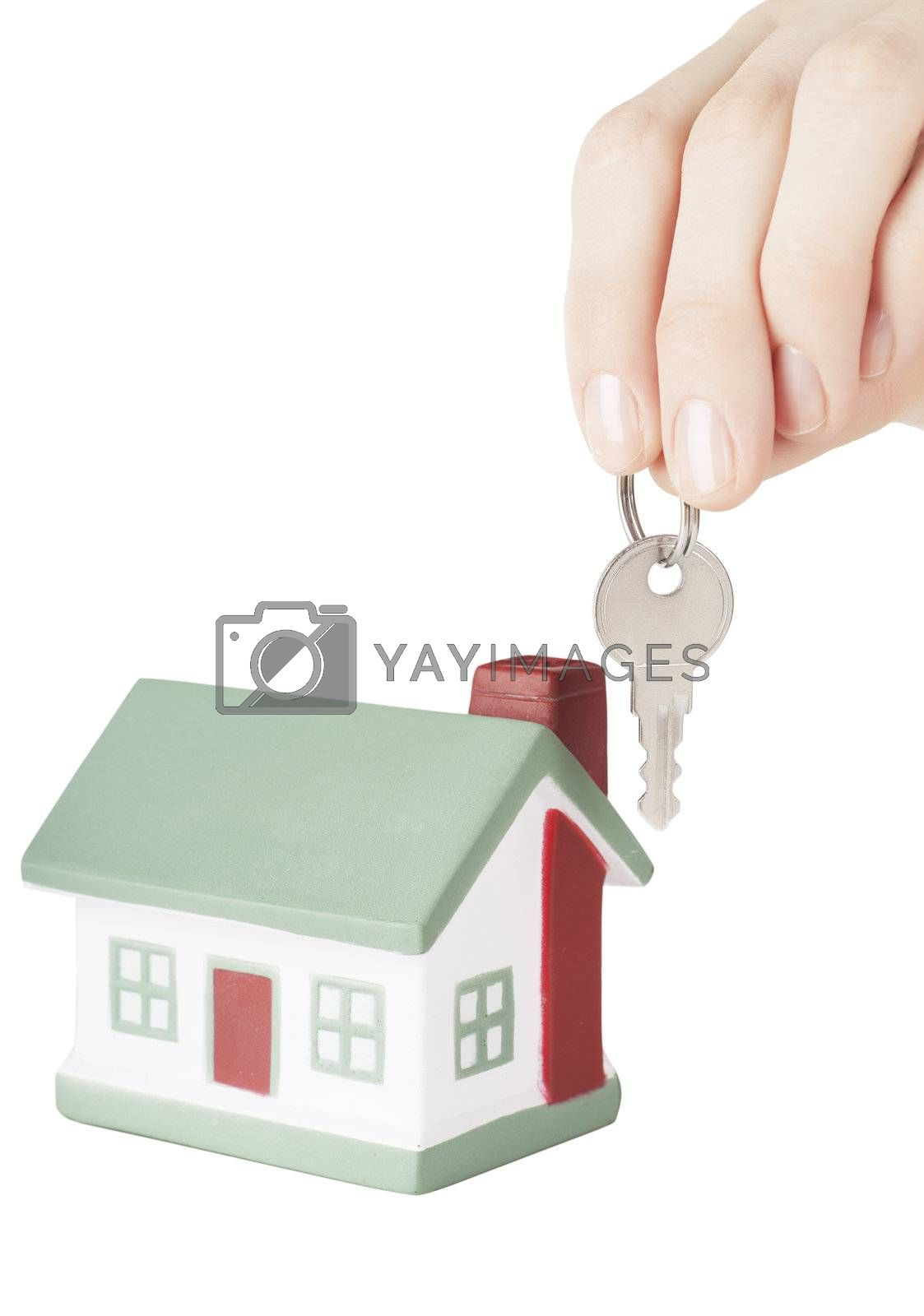 Little house toy and hand with key isolated over white background