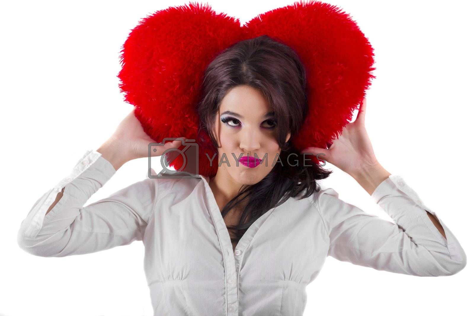 View of a beautiful girl with a red heart in a white background.