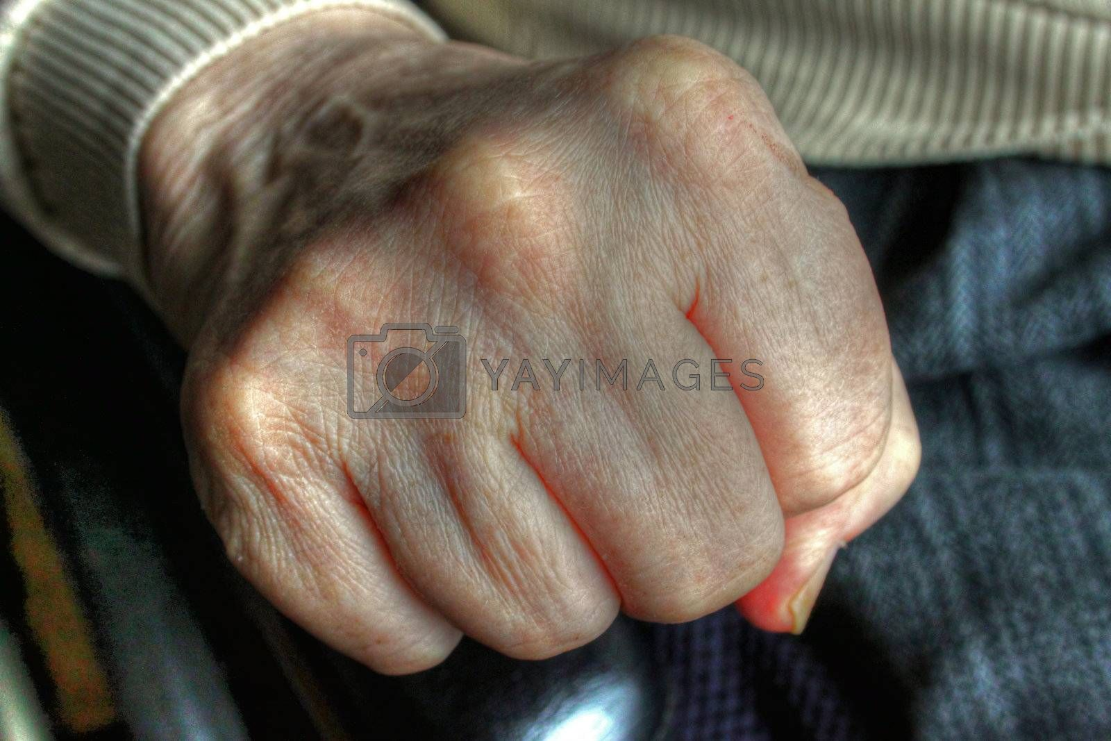 Elderly lady hand making a fist showing knuckles
