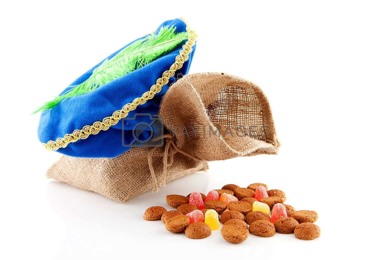 Typical Dutch celebration: Sinterklaas with bag and ginger nuts, ready for the kids in december. Isolated on white background