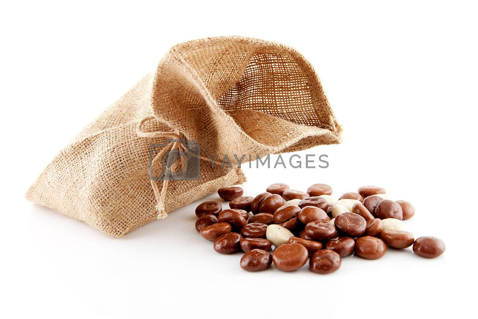 Typical Dutch celebration: Sinterklaas with bag and chocolate ginger nuts, ready for the kids in december. Isolated on white background