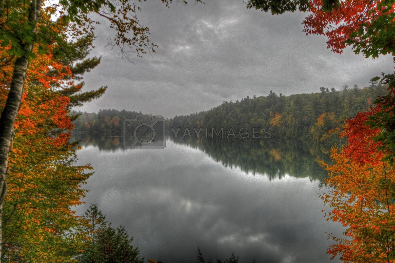 Fall foilage reflecting on Pink Lake in Gatineau Park