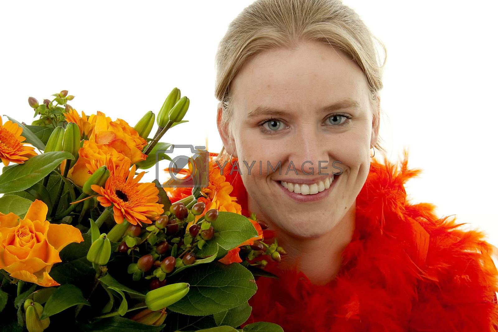 Woman with beautiful orange flowers in closeup over white background