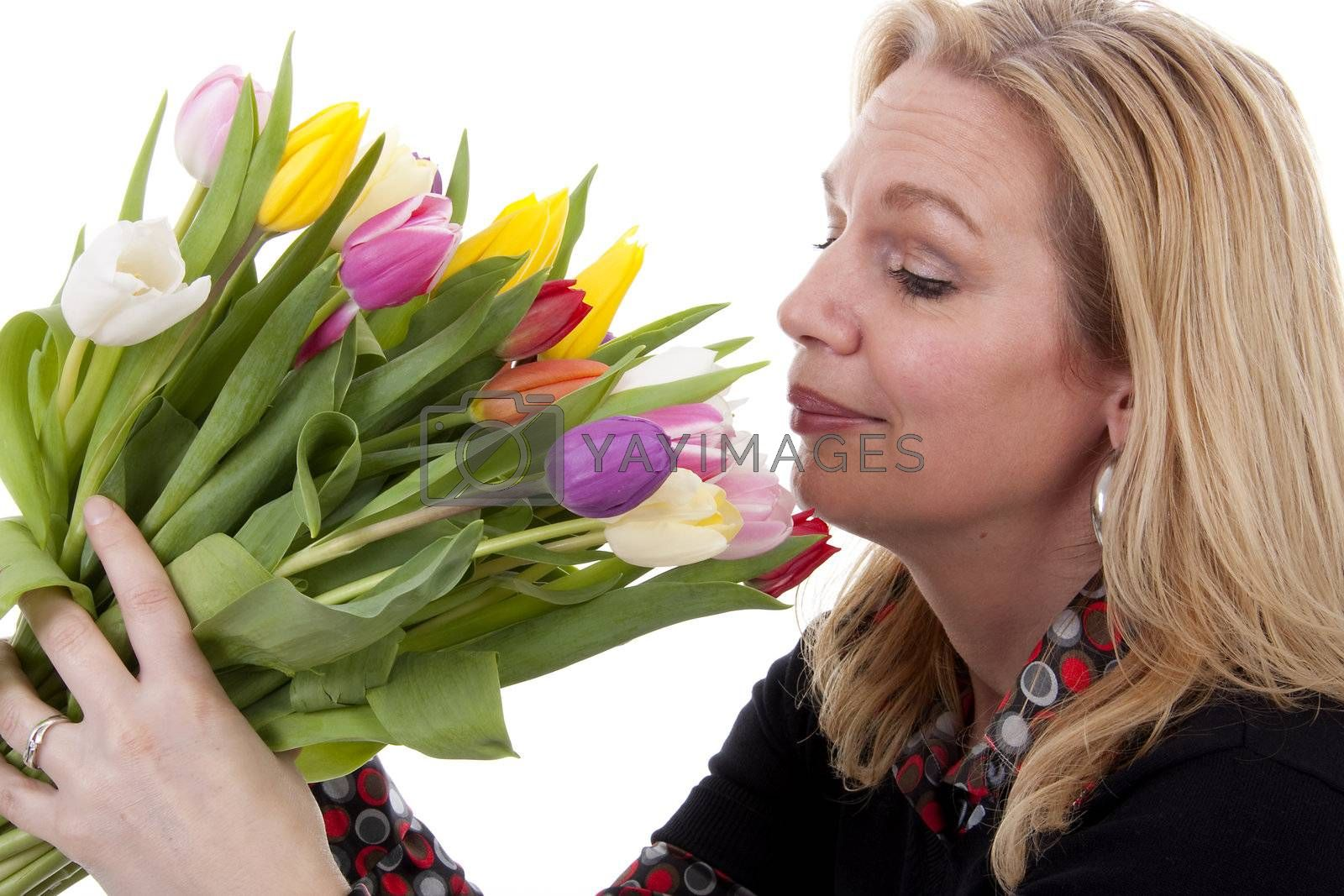 Woman with Dutch tulip flowers over white background