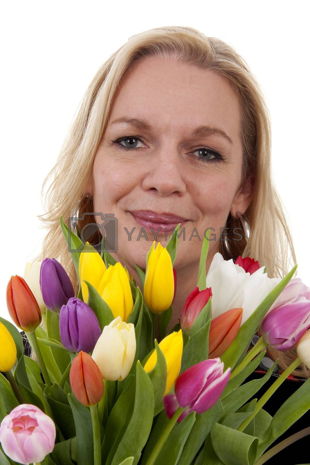 Woman with Dutch tulip flowers in closeup over white background