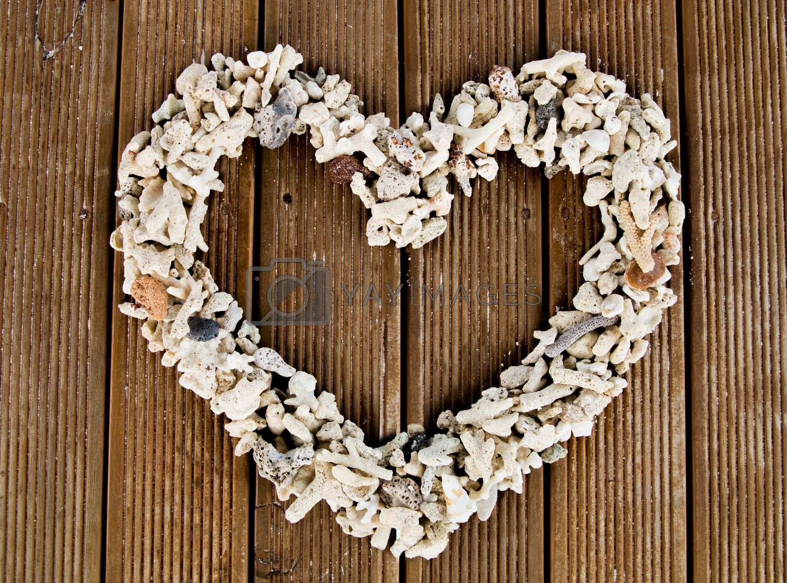 Wooden planks background with heart shape.