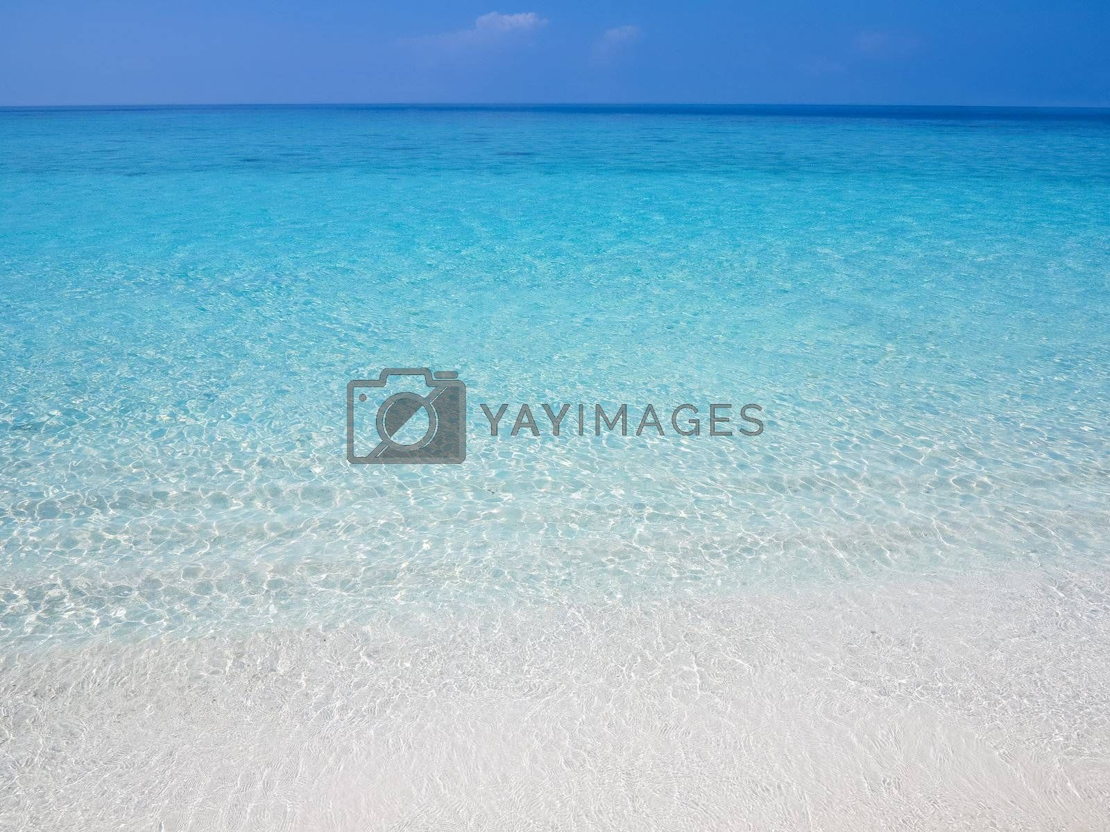 Calm and smooth ocean with water ripples by get4net