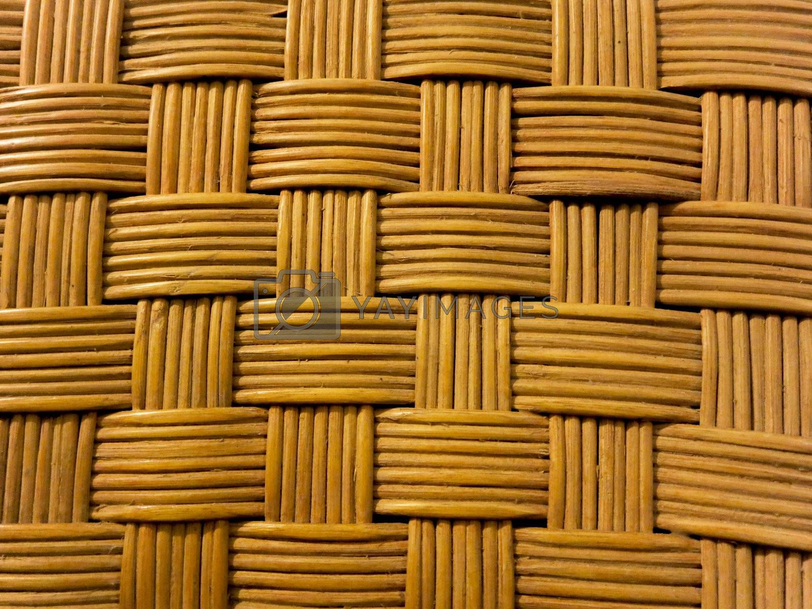Closeup shot of a textured woven bamboo with natural pattern.