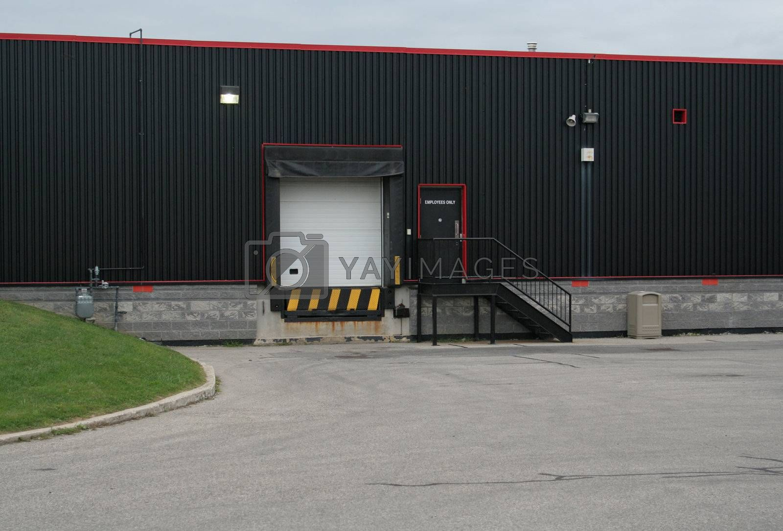 The exterior loading dock of an industrial warehouse.