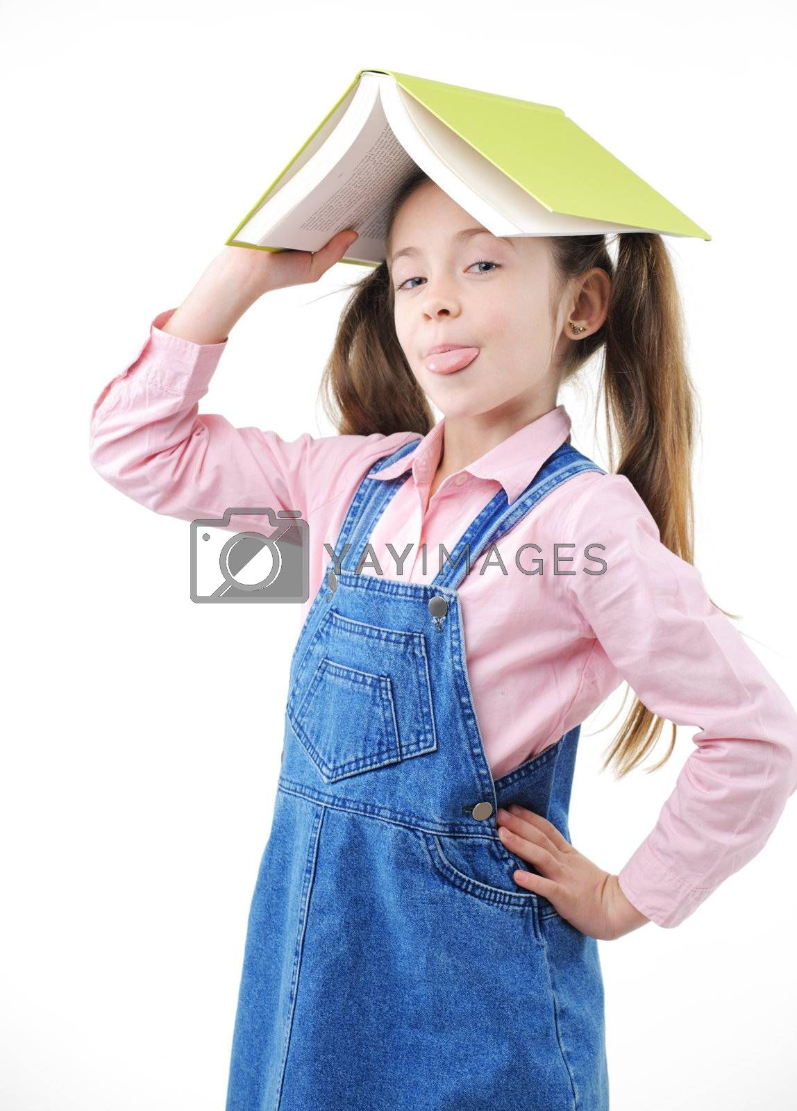 Cute girl with book on her head, white background