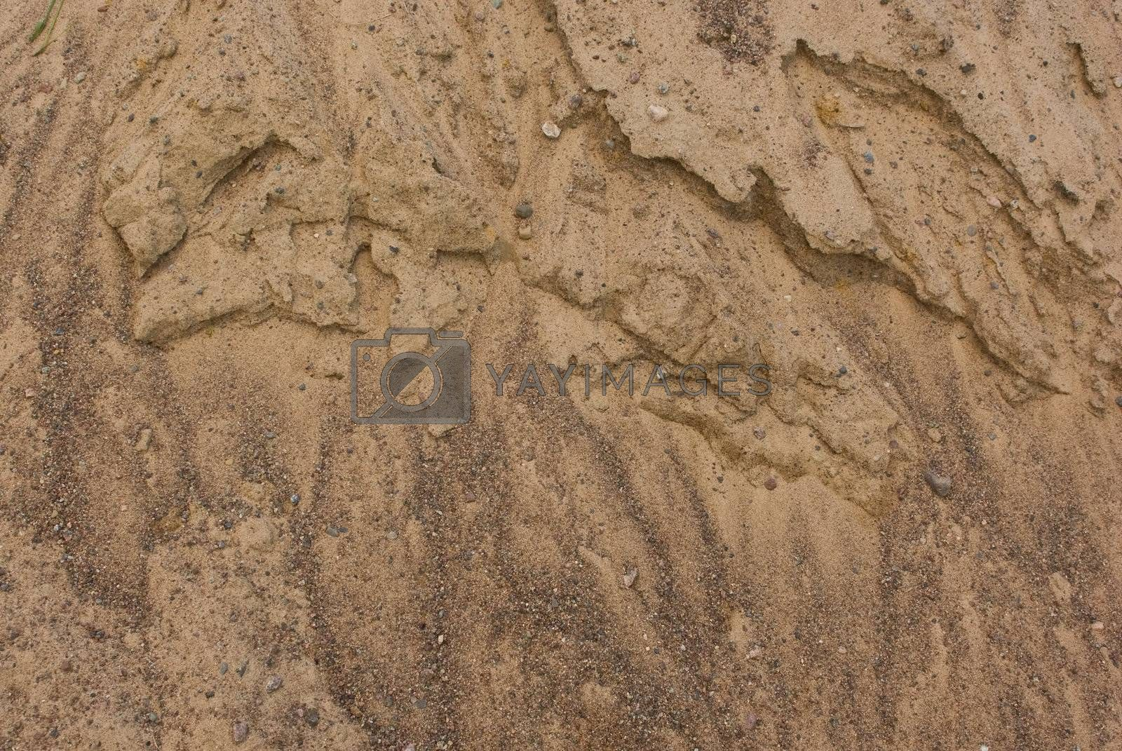 Weathered texture of sand pile surface as background