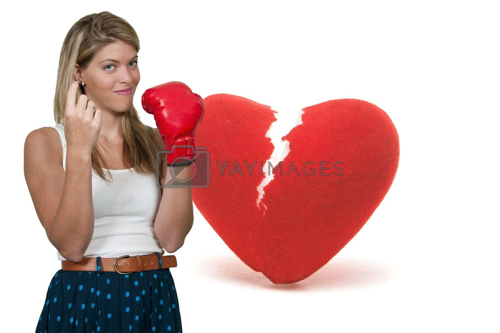A beautiful woman wearing a boxing glove signaling with her finger for someone to come here