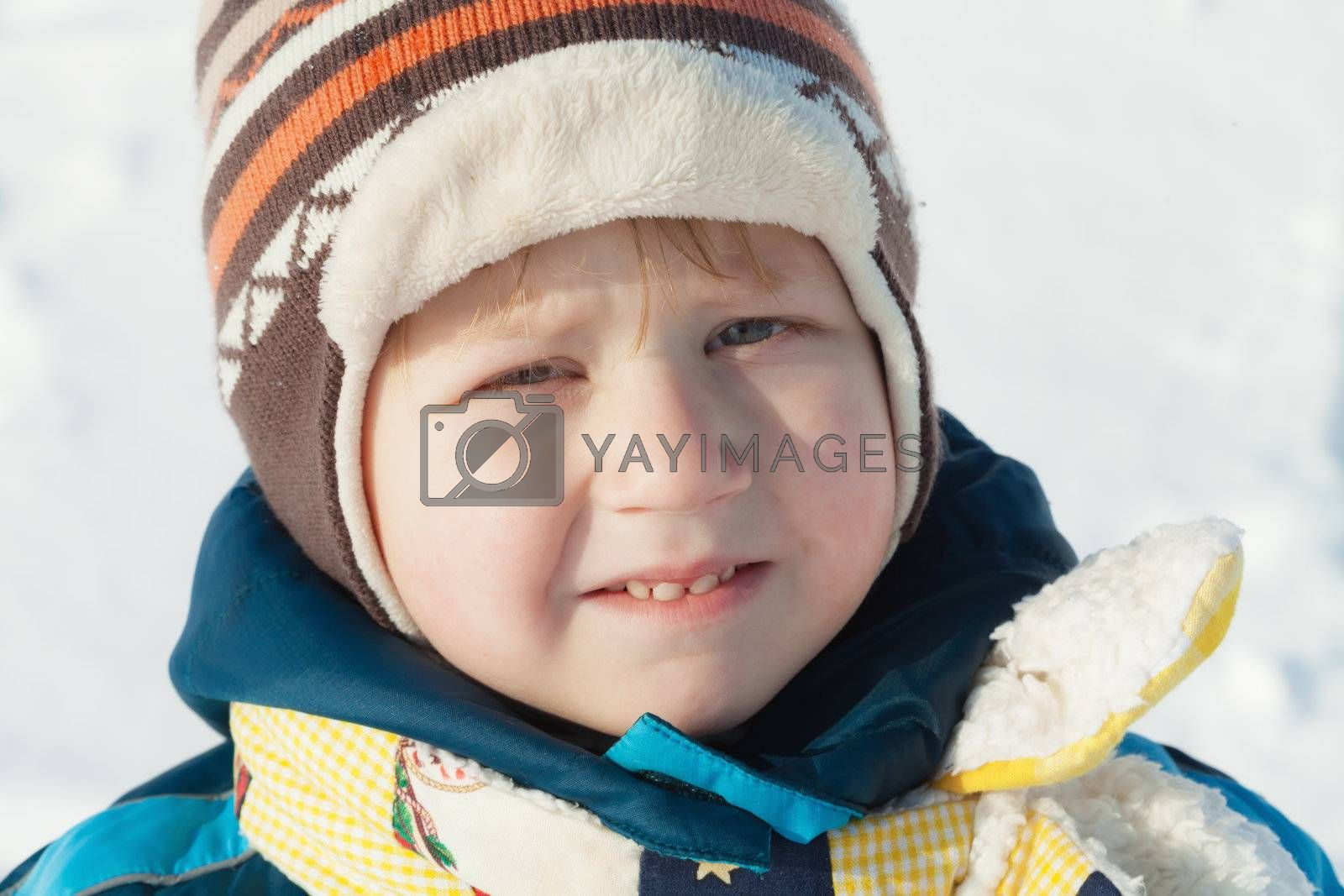 Outdoor winter portrait of a little boy