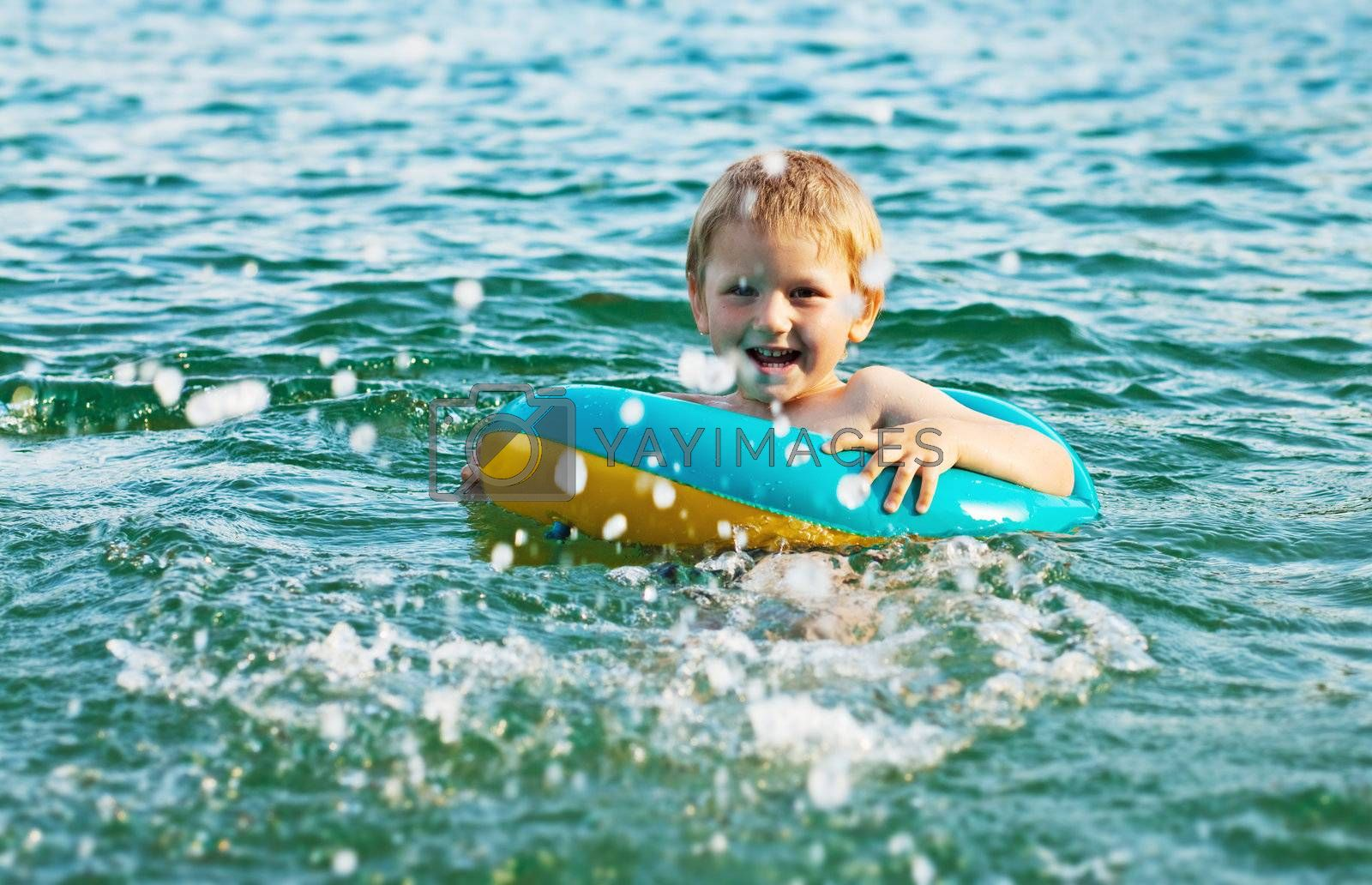Little boy having fun in the water