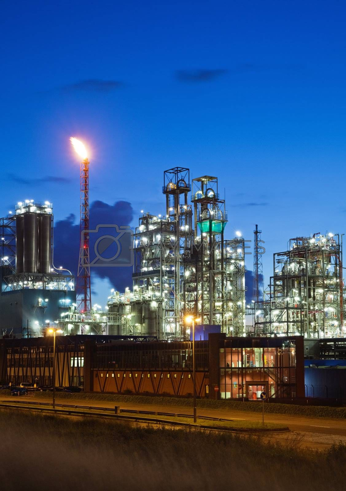 Illuminated petrochemical plant in twilight (Antwerp port, Belgium)