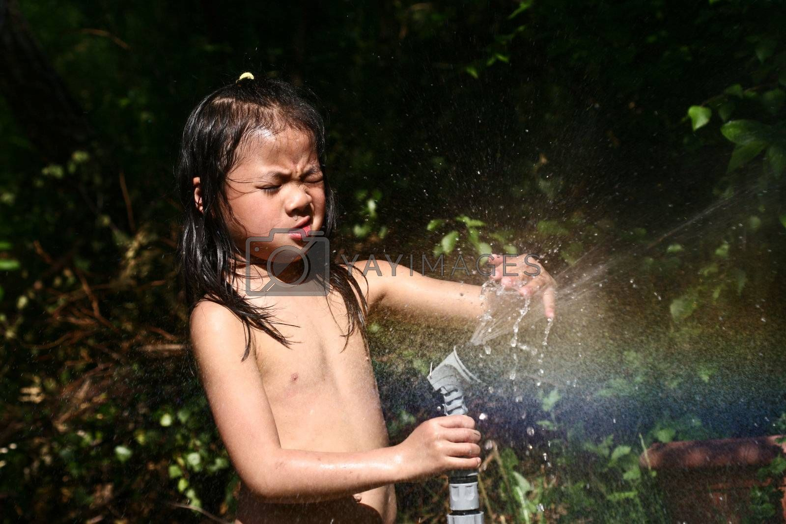 close up of child head splashing with water